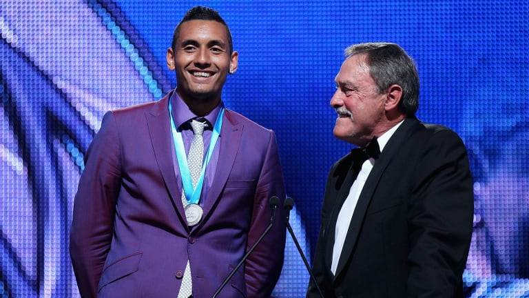 Nick Kyrgios on stage with John Newcombe at Crown Palladium in Melbourne after receiving the 2014 Newcombe Medal.
