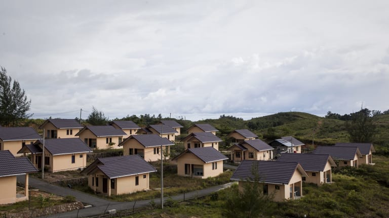 A hilltop settlement of recently built houses in Lhok Kruet is mostly abandoned, as they have no running water.