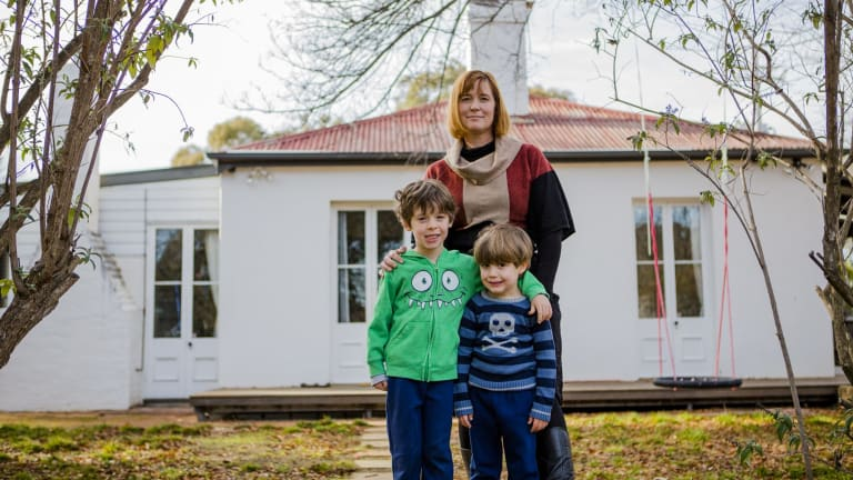 Kate Gauthier is concerned about heritage being destroyed at Oaks Estate. She stands with her two sons Atticus 5, and Luther 4. The Canberra Times