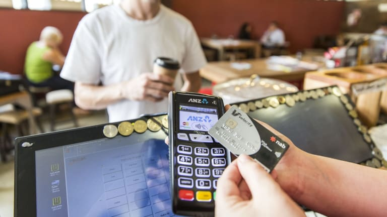 The tap and go boom has created a significant rise in some retailers' debit card costs.