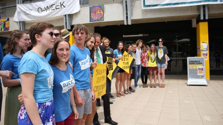 Greens MLA Shane Rattenbury and ANU students protest outside the university's Commonwealth Bank branch.