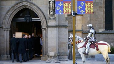 The coffin containing the remains of Richard III is carried into Leicester Cathedral.