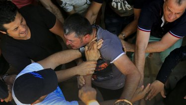Tensions rise: Syrian refugees clash during registration on Kos.