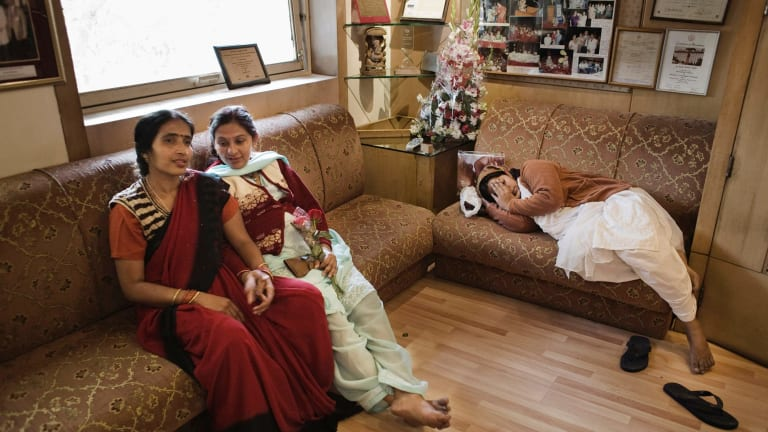 Surrogates Neelam Jaisawal (centre) and Neelam Chauhum (right) wait for a check-up at the Delhi Fertility and Research Centre in New Delhi in 2009.