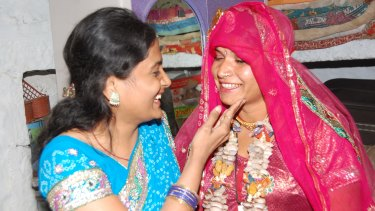 Lakshmi Sargara, 19, (right) on her second wedding day - to a man of her choice - with Kriti Bharti.