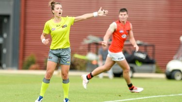 Taking charge: Field umpire Eleni Glouftsis  awards a free kick in the Essendon intra-club game.