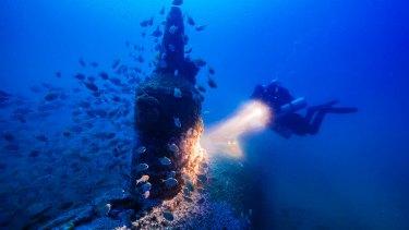 Deep blue: Maritime archaeologist Matt Carter diving on the wreck of the Japanese midget submarine off Bungan Head.