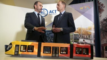 Canberra Metro Consortium chairman Mark Lynch and Deputy Chief Minister Simon Corbell.