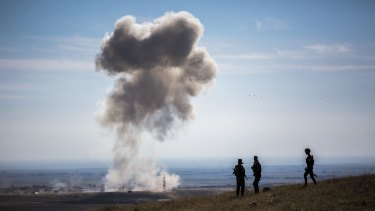 A car bomb, from the Islamic State, explodes near peshmerga vehicles that had just entered a small village on Highway 47, in Mount Sinjar, Iraq.