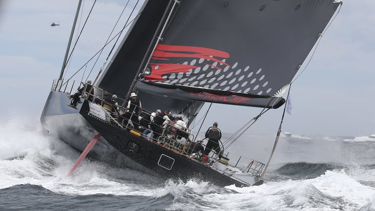 Comanche sails out of the heads.