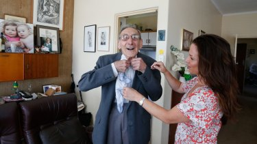 Lisa Slater helps Jack Moulos get ready for an outing.