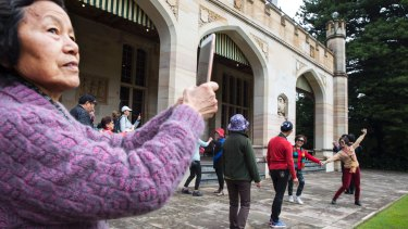 Chinese tourists enjoy a dance during an open day at Government House in Sydney.
