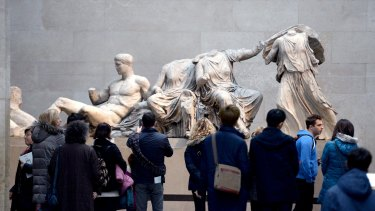 Visitors look at the Parthenon Marbles, also known as the Elgin Marbles, in the British Museum in London.