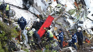 Rescue workers comb through the wreckage of a plane crash south of Medellin in Colombia.