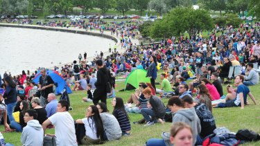 People gather for the Australia Day fireworks on the shores of Lake Burley Griffin. Canberra's population was hovering around 392,000 in the middle of 2015 and will probably reach 400,000 within the next 12 months.