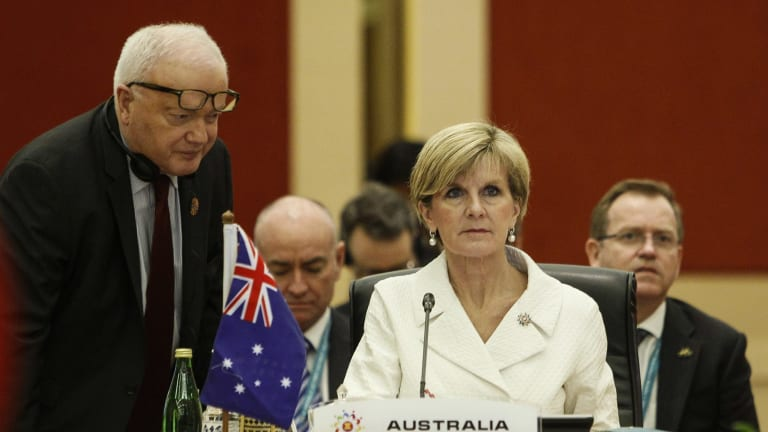 Australian Foreign Minister Julie Bishop listens to her staff before the ASEAN meeting on Wednesday.