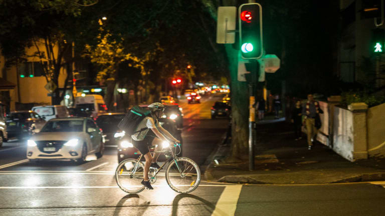 A meal delivery rider on Crown Street in Surry Hills makes a dash through red lights.