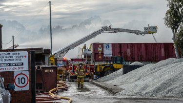 Firefighters at the recycling plant in Coolaroo.