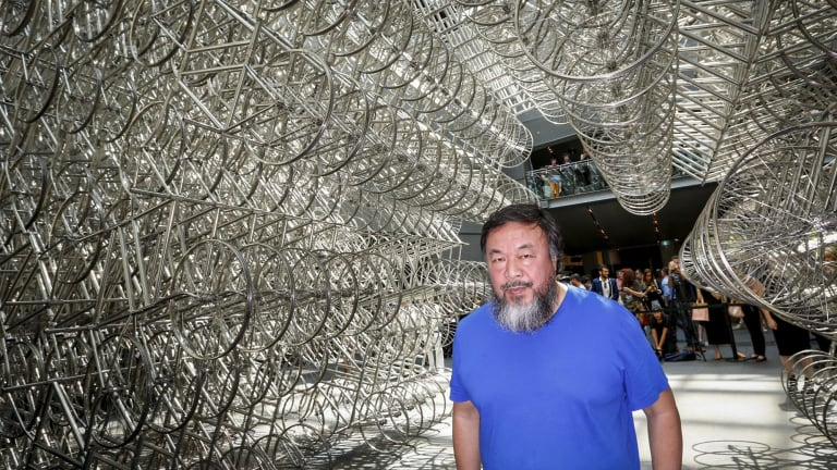 Ai Wei Wei under his bicycle sculpture at the NGV.