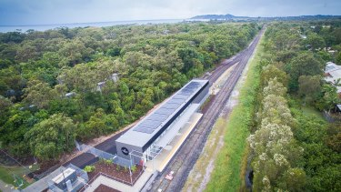 Byron's North Beach station with a view south to Byron Bay along the train line. Solar panels on the shed roof will power the world's first solar train.