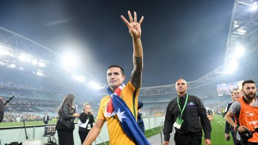 Superstar Tim Cahill waves to fans after the match.