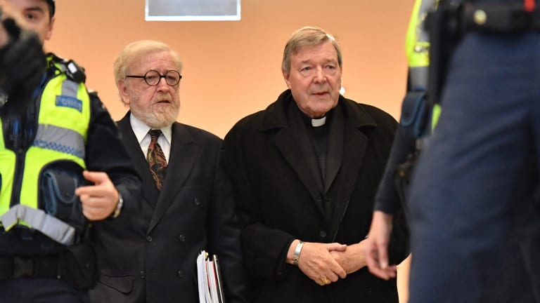 Cardinal Pell, with his lawyer Robert Richter, QC (left), arrives at Melbourne Magistrates Court.