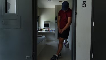 An inmate stands at the entrance to his cell inside Cobham Juvenile Justice Centre.