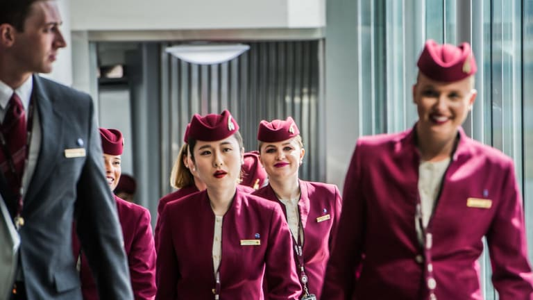 The Qatar crew disembark the plane for a brief stopover in Canberra before the flight to Doha.