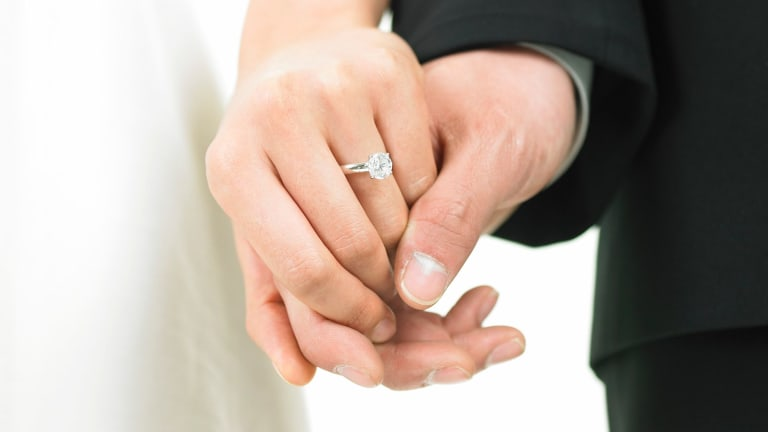A Brisbane pair allegedly profited from elaborate marriage visa scam.