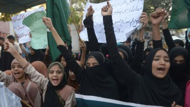 Pakistani students demonstrate against the Taliban in Karachi on Saturday.