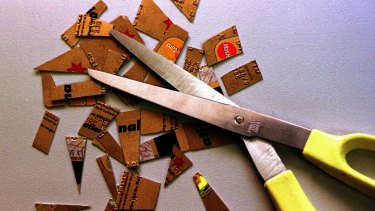 Simple solution: Curb your spending by cutting up your credit cards.