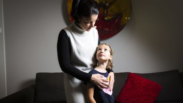 Simone Cariss with her six-year-old daughter Asha. Simone is petitioning for Asha to be able to wear pants as part of her school uniform.