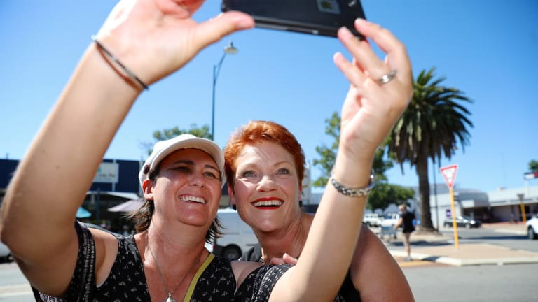 One Nation leader Pauline Hanson has a picture taken with a member of the public while campaigning in Mandurah, south of Perth.