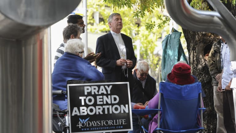 A prayer vigil outside a Canberra abortion clinic before it was made illegal.