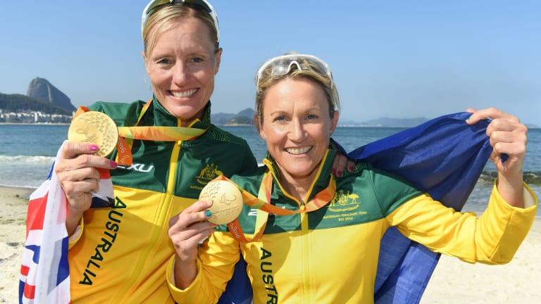 Katie Kelly with guide Michellie Jones wins gold in the Women's PT5 Triathlon.