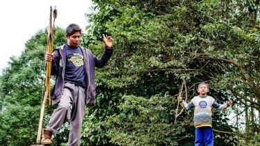 Kaiowa boys guard the entrance to the Yvu homestead.