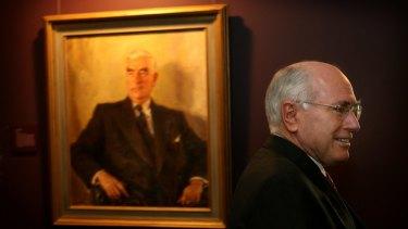 John Howard with Sir Robert Menzies looking over his shoulder.