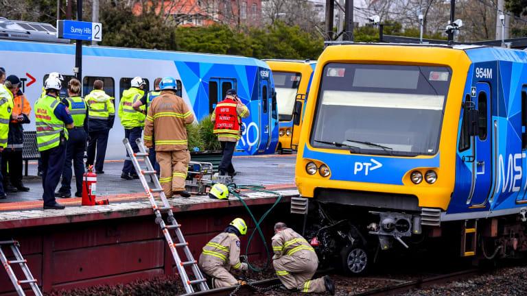 Two elderly women died when a car was hit by a train near Surrey Hills station.