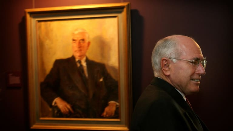 John Howard with Sir Robert Menzies looking over his shoulder.