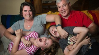 Teresa Crawford and Michael Hess with their nine-year-old twins, Corinne and Henry.