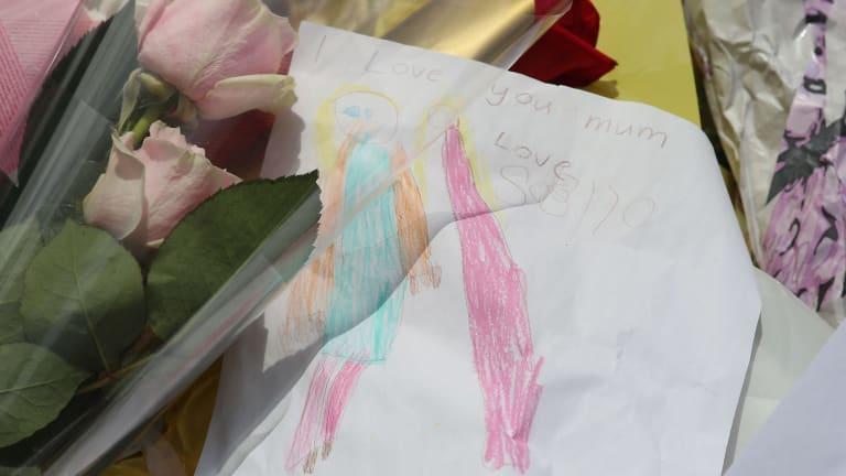 "A note left by Katrina Dawson's child, which reads ""I love you Mum. Love Sasha."""