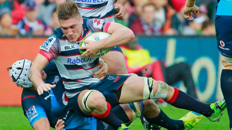 Maiden try: Sean McMahon of the Rebels is tackled during the round match against the Bulls.