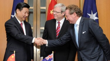 June 2010: Then vice-president and now President Xi Jinping, left, shakes hands with Fortescue Metals Group CEO Andrew Forrest as prime minister Kevin Rudd looks on in Canberra.