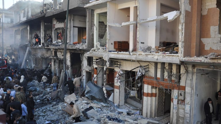 Damaged buildings in the Syrian government-held neighborhood of Zahraa, Homs, in 2015.