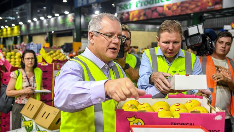 Federal Treasurer Scott Morrison (front left) and Craig Laundy visit the Sydney Markets in Homebush in 2017.