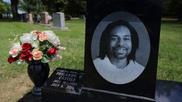 A bouquet of flowers adorns the grave of Philando Castile on July 16, 2017, the one-year anniversary of his death.