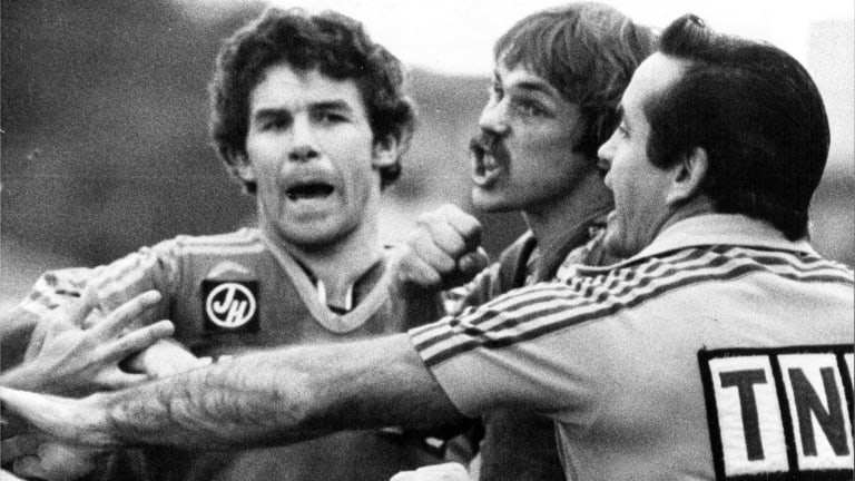 Kevin Roberts intervenes as Parramatta's Steve Sharp gets angry against St George.