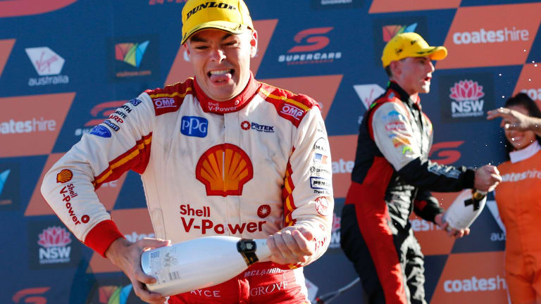 Scott McLaughlin celebrates on the podium.