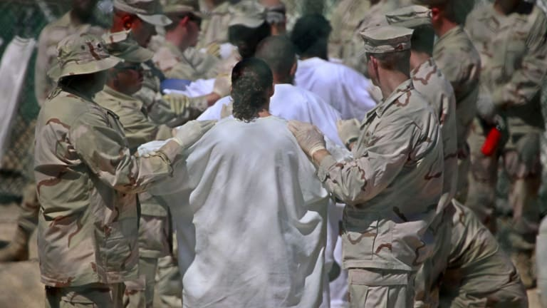 Guards and detainees in Guantanamo's Camp 4 detention facility in 2009.