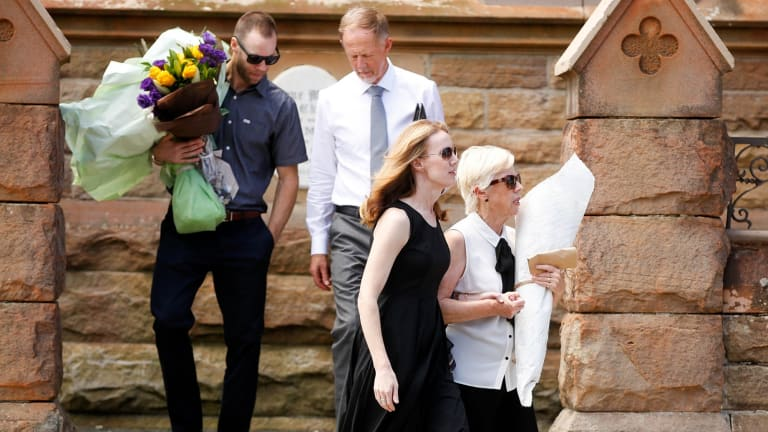 Brother Dallas, father Dudley, sister Cydane and mother Orlis Morgan leave the funeral of their son and pilot Gareth Morgan.